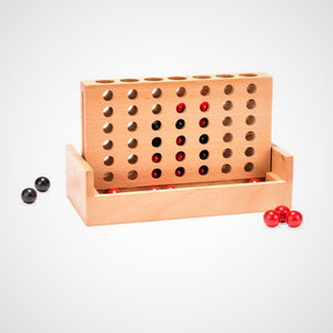 Game itself with upright wooden slotted game board and red and black marbles.