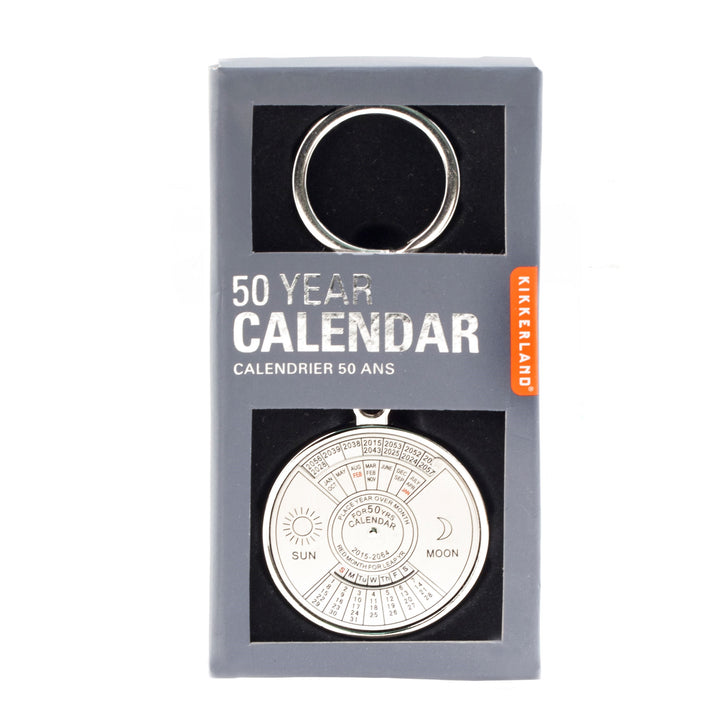 Silver calendar key ring in its gray packaging box. 50-year calendar with al of the numbers, months, years and sun and moon showing through