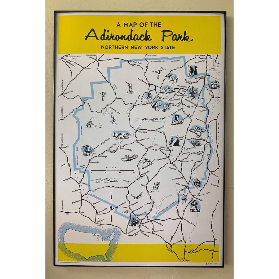 Black and white printed map with blue line outline of the Adirondack Park and cute drawings designating fun and key aspects of the Park,  black border and two yellow bands top and bottom on beige background