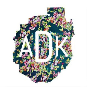 Decal of the Adirondack Park boundaries in navy floral with white ADK lettering centered.