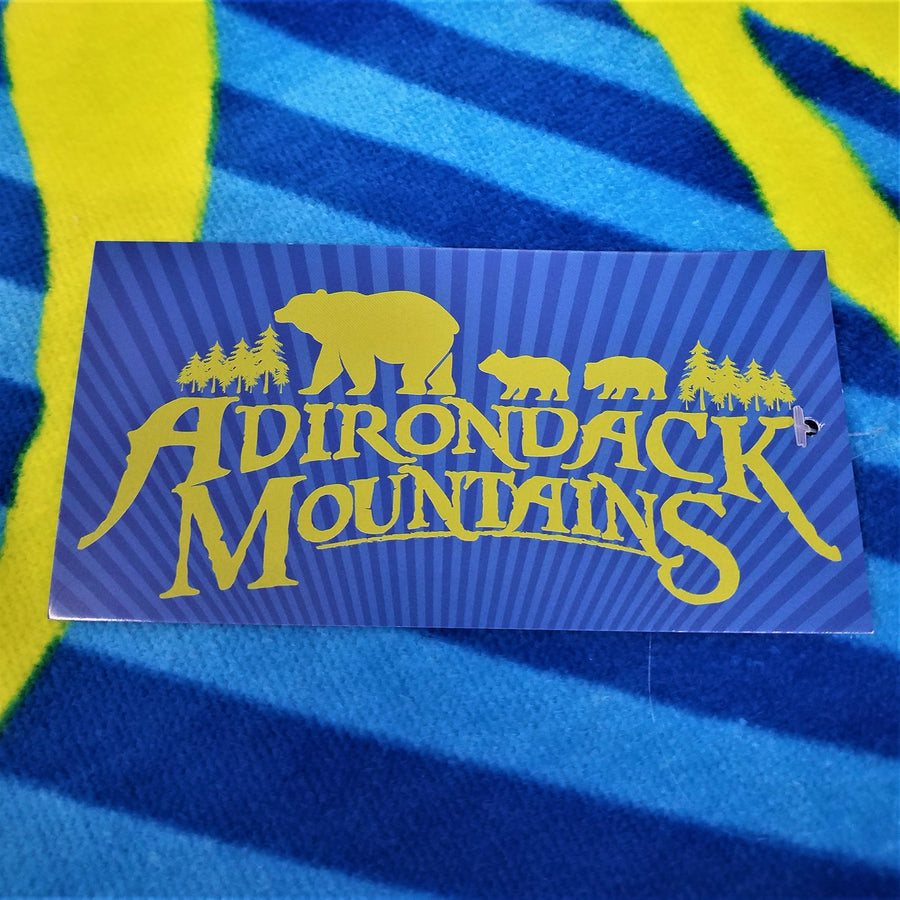Dark blue, light blue and yellow stripes with rectangular patch of bears and mountains silhouette in gold