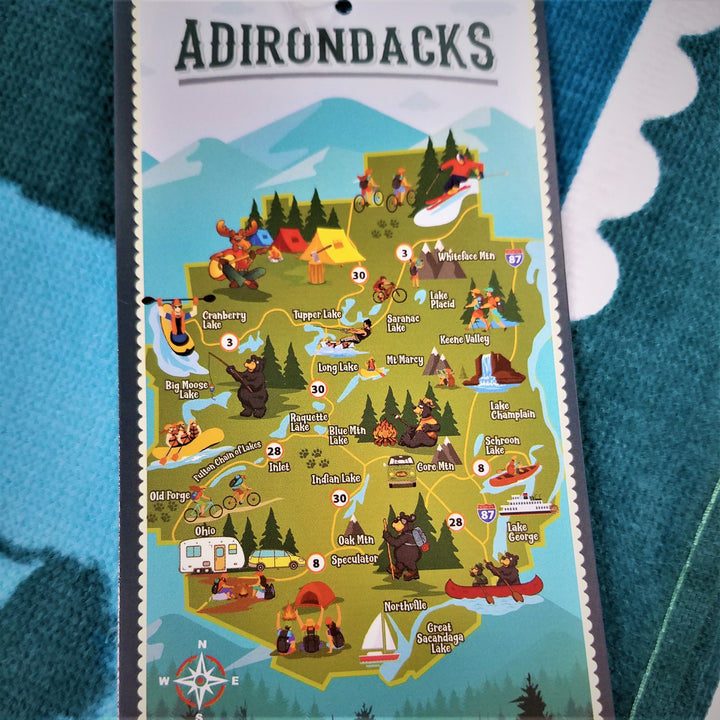 Vertical promotion card with the full-color map of the park and its attractions atop the actual terry cloth towel.