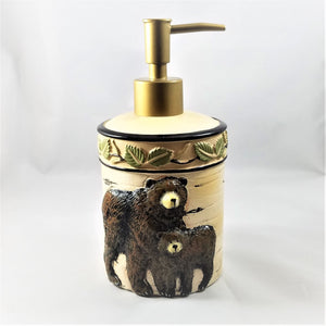 Soap dispenser with a big black bear and a small black bear featured on the bottom under a band of delicate green leaves. A gold-colored dispenser sits on top.