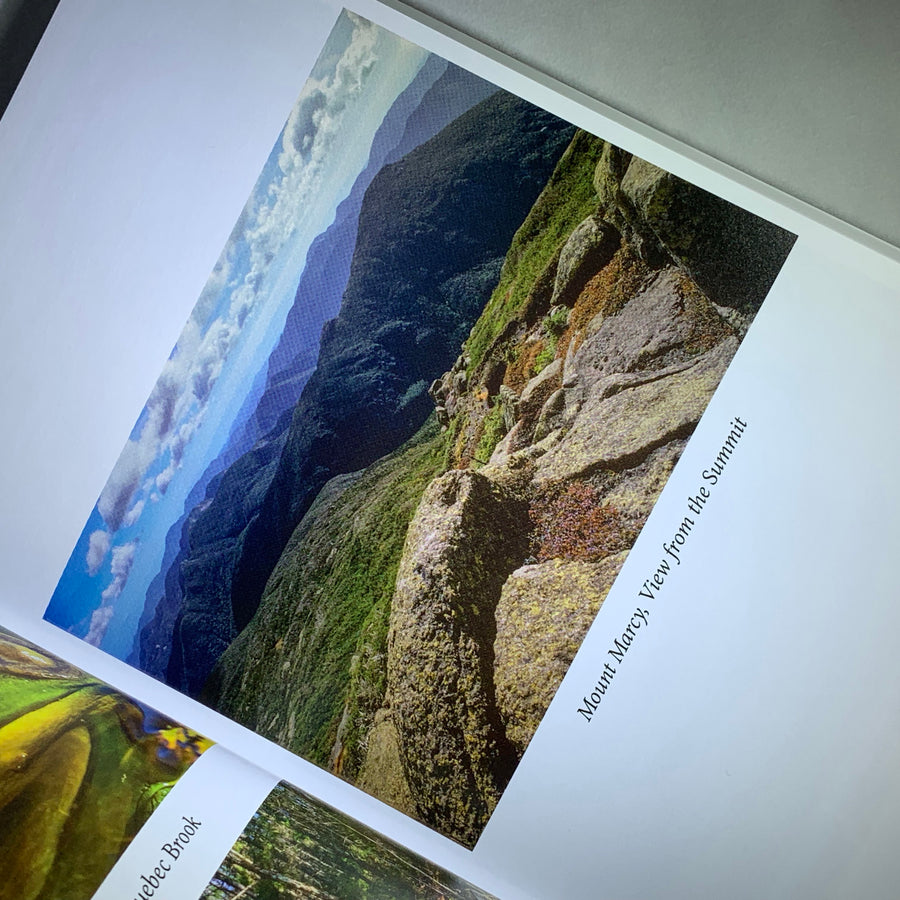 Photo from book displayed on the diagonal. A view of Mount Marcy from the Summit