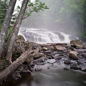 Photo card cover of Barry Lobdell's Buttermilk Falls--tree-lined waterfalls and river rocks