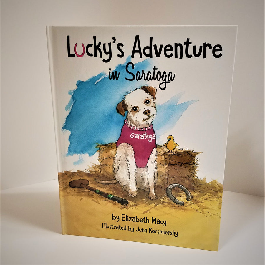Cover of hardcover book Lucky's Adventure in Saratoga. Dog in Saratoga garb next to a chick on a haystack depicted in center of book cover.