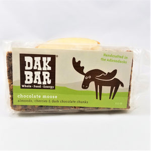 The chocolate moose Dak bar standing upright with some of the bar peeking through the bottom and left side of the packaging.