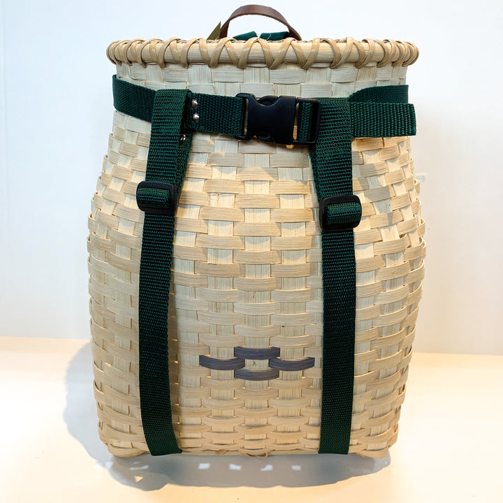 Front of adult pack basket with dark brown strap trim
