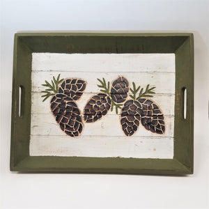 Green trim-edged tray with white base and 6 pine cones depicted on surface.