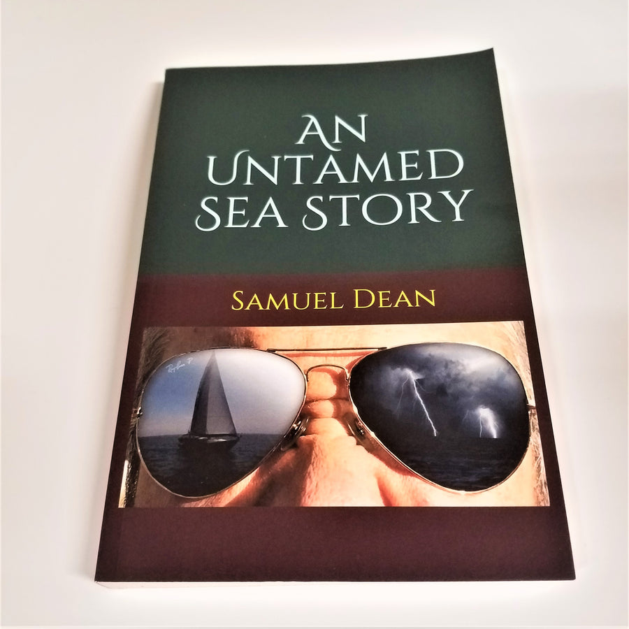 Flat book cover top half white text An Untamed Sea Story above brown bottom outline with the author's name Samuel Dean in yellow type above a photo close-up of a person's eyes and nose. The person is wearing sunglasses with a sailboat reflected in one lens and black-and-white streaming fireworks or explosions over water in the other lens.