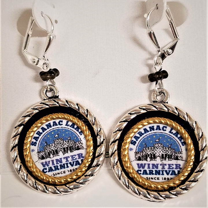 Dangling Winter Carnival circular earrings. Gold braided bands and black band surround Saranac Lake Winter Carnival blue, white & black logo.