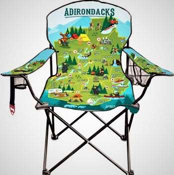 Folding chair opened up to display the colorful Adirondack Park illustrated map which takes up the whole back and seat. More colors and scenery on the arms as well.