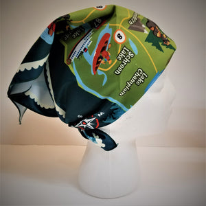 Adirondack map bandana tied on a mannequin head displaying a bright green section with a red kayak and black border.