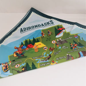 Adirondacks printed at the top triangle of this folded bandana with black border around a brightly colored map of icons and towns in the Adirondack mountains