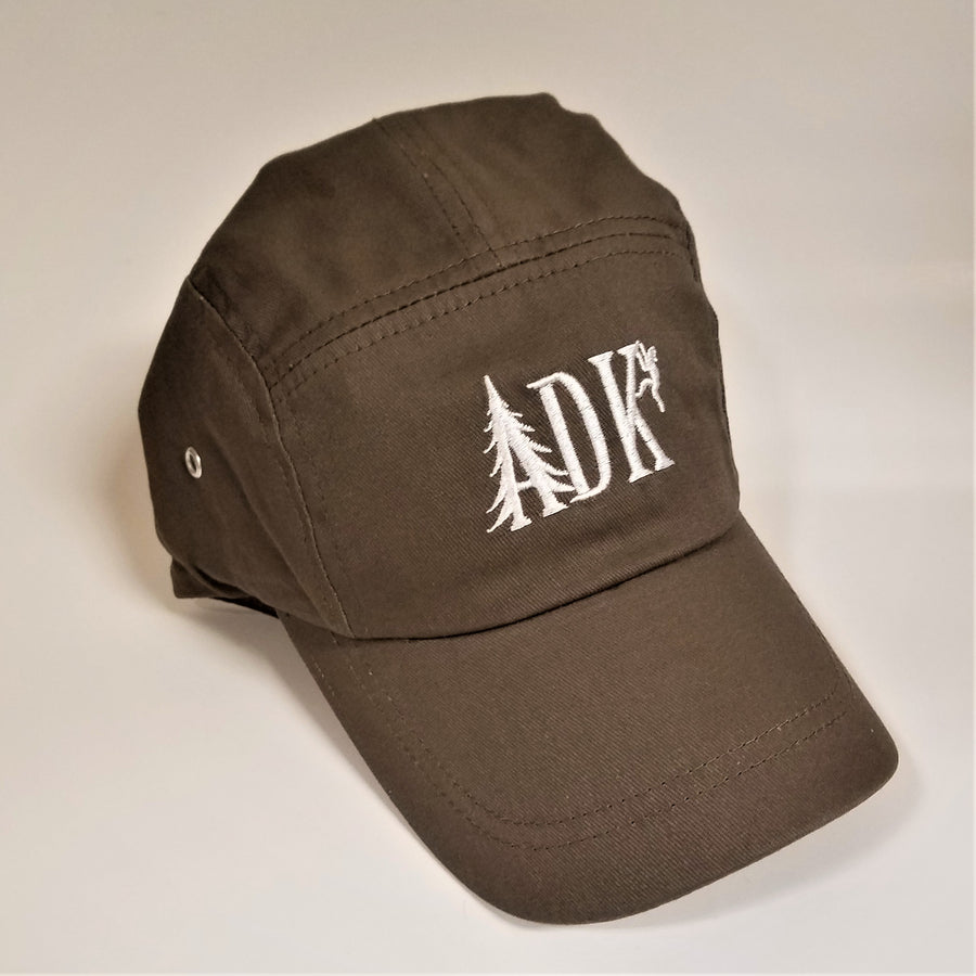 ADK panel cap in brown with white embroidery featuring the letters ADK with the A in the style of a pine tree and a small hiker climbing the top of the K