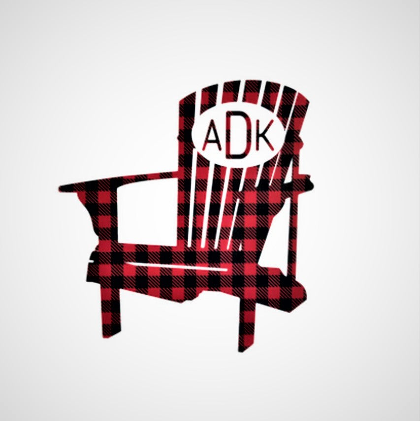 Decal of Adirondack chair in buffalo plaid with white oval and matching plaid lettering ADK on chair back.