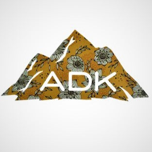 Adirondack mountain decal in yellow floral pattern with white ADK lettering printed at the base of the mountain