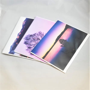 Three of photographer Barry Lobdell's Adirondack photo cards fanned out with Blue Sunset with Adirondack chair facing water and mountains on top.
