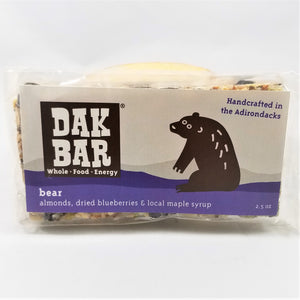 The bear Dak bar stands upright with some of the actual bar peeking through the top and bottom of the packaging.