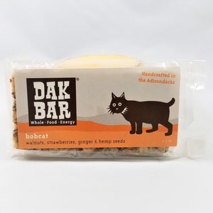 The bobcat Dak bar stands upright with some of the actual bar peeking through the packaging to the left and at the bottom.