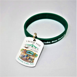 wristband and attached Adirondack Carousel zipper pull featuring the carousel itself