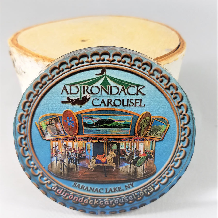 close up of Adirondack Carousel magnet with logo and carousel depicted