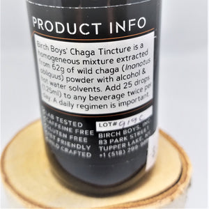 Back label of Birch Boy's Chaga Tincture--a homogeneous mixture extracted from 62g of wild chaga (Inonotuc obliquus) power with alcohol & hot water solvents. Add 25 drops (1.25ml) to any beverage twice per day. A daily regimen is important.