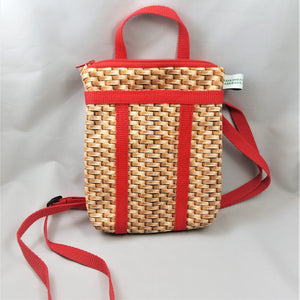 upright full red-strap bag with most of straps showing