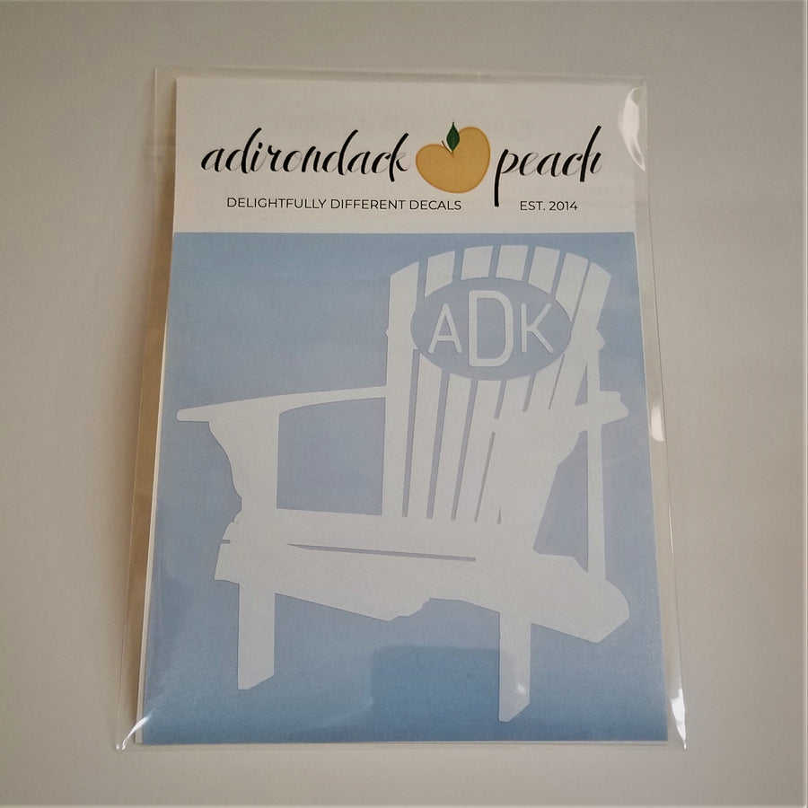 Decal of Adirondack chair in white with an oval and white lettering ADK on chair back.