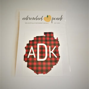 Decal of the Adirondack Park boundaries in buffalo plaid with white ADK lettering centered in the design.