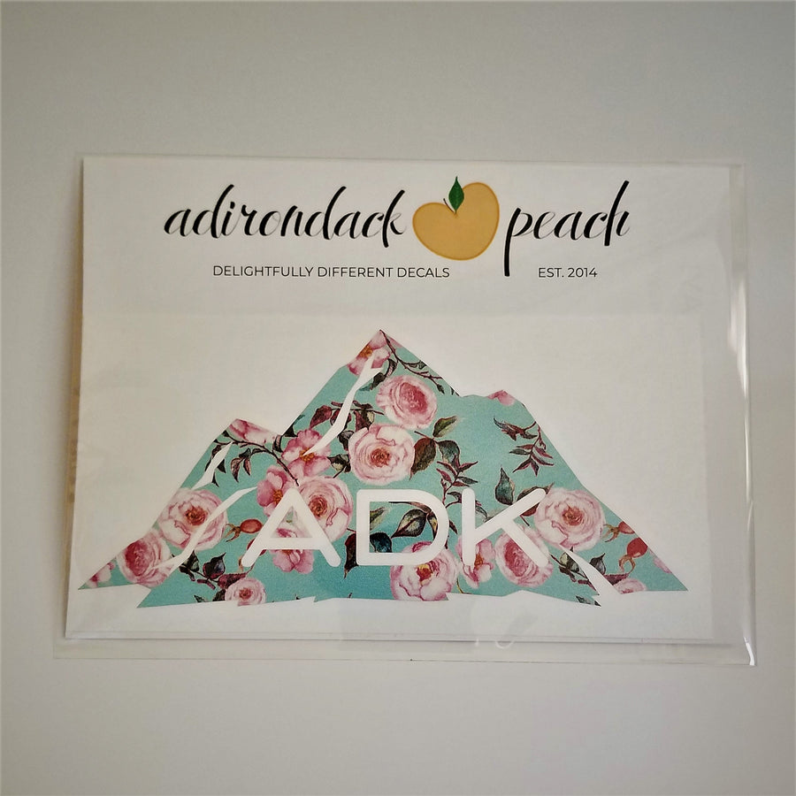 Adirondack mountain decal in aqua floral pattern with white ADK lettering printed at the base of the mountain