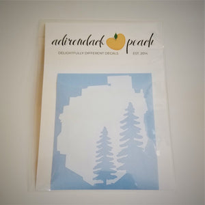 Decal of the Adirondack Park boundaries in white with two pine trees in pale blue on the bottom right. Background color also pale blue.