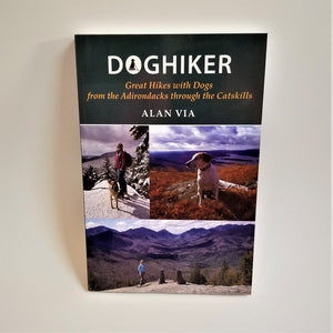Cover of book showcases 3 color photos: one of a women and dog standing in a snow-covered landsacpe, one with a single dog looking out from what looks like the top of the world on an  autumn-hued mountain with the lake country behind. The third is a mountain backdrop with a woman and two dogs posed with their backs to the camera looking at the incredible view.