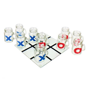 Glass game board with blue x-painted glasses and red o-painted glasses all spread out across board