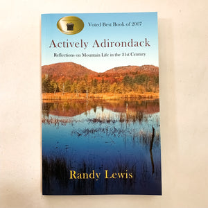 Book cover featuring Adirondack mountains reflected in the area lakes