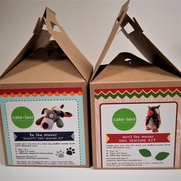 "Two card board box kits featuring the labels for the ""Scrappy Dog"" sewing kit and the Owl sewing kit. The dog is on the left and includes a picture of the finished dog lying down. The dog has a white snout with a brown nose, brown head with white X eyes, one green leg, one brown, one orange, and a brown tail. The owl is pictured standing upright and has orange feet and beak with a mostly brown body, X eyes inside a white and gray round."