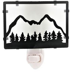 Black framed silhouetted mountain and trees on white background above the nightlight switch