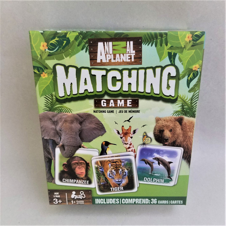Cover of game box with jungle motif including game card photos of a chimpanzee, tiger, dolphin, with a bear, an elephant, giragge, penguin and butterfly above the cards.