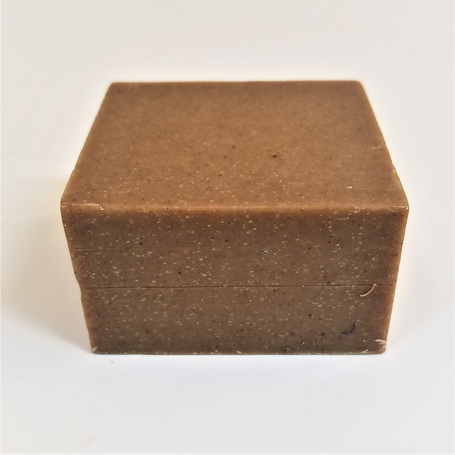 Brown soap bar square with tiny off-white speckles.
