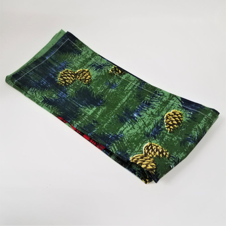 Tea towel backside with pine cones and green-blue background