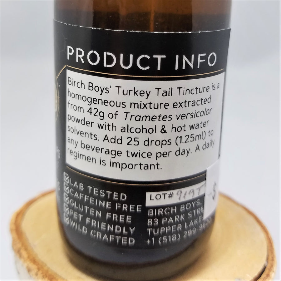 Back label of Birch Boys' Turkey Tail Tincture: a homogeneous mixture extracted from 42g of Trametes versicolor power with alcohol & hot water solvents. Add 25 drops (1.25 ml) to any beverage twice per day. A daily regimen is important.