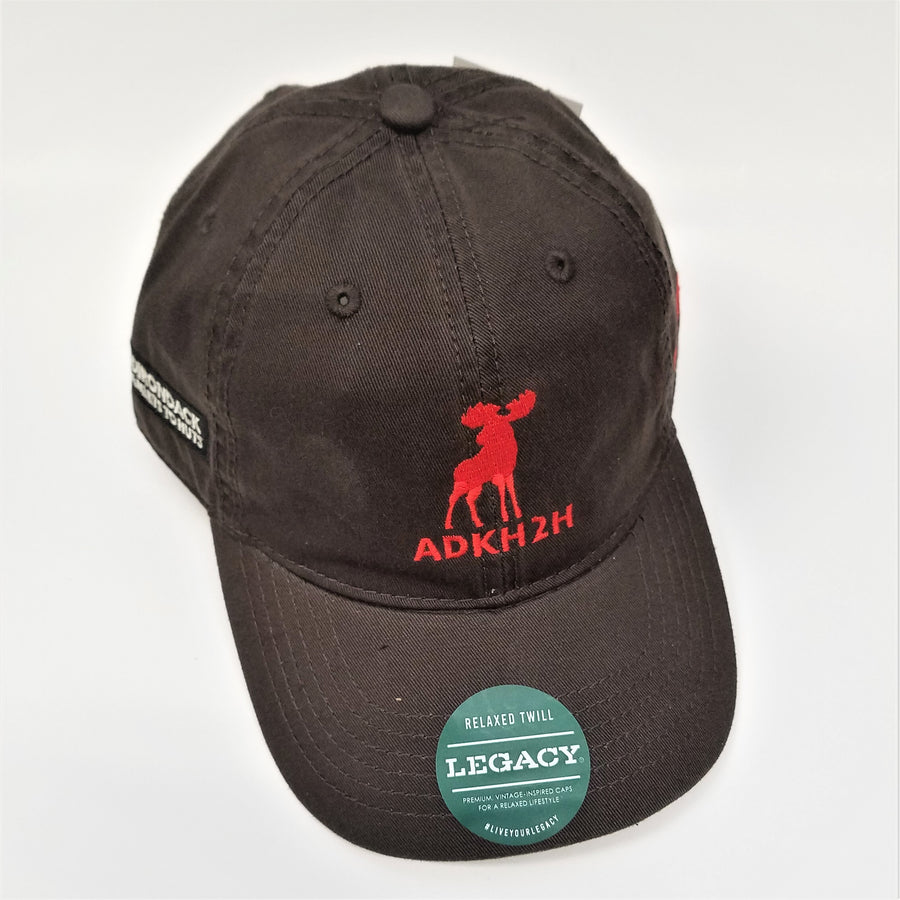 side front view of pre-washed looking brown cap with red moose and red lettering in front and white lettering on the side. Green label with white text on brim.