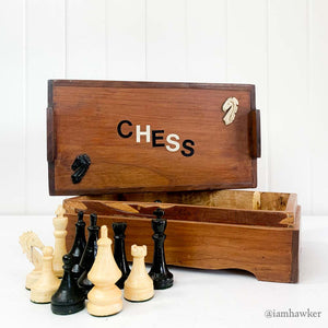 WOODEN BOX OF CHESS PIECES