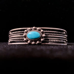 ORNATE SILVER CUFF WITH TURQUOISE STONE
