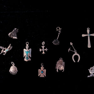 SILVER CHARMS IN SOUTHWESTERN DESIGNS