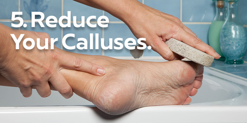 Reduce calluses image of foot in bathtub with pumice stone used to reduce calluses and rough skin on feet