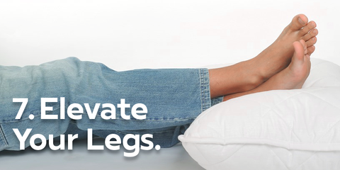 Elevate legs image of legs raised on pillow so feet are above heart and blood flow is optimal