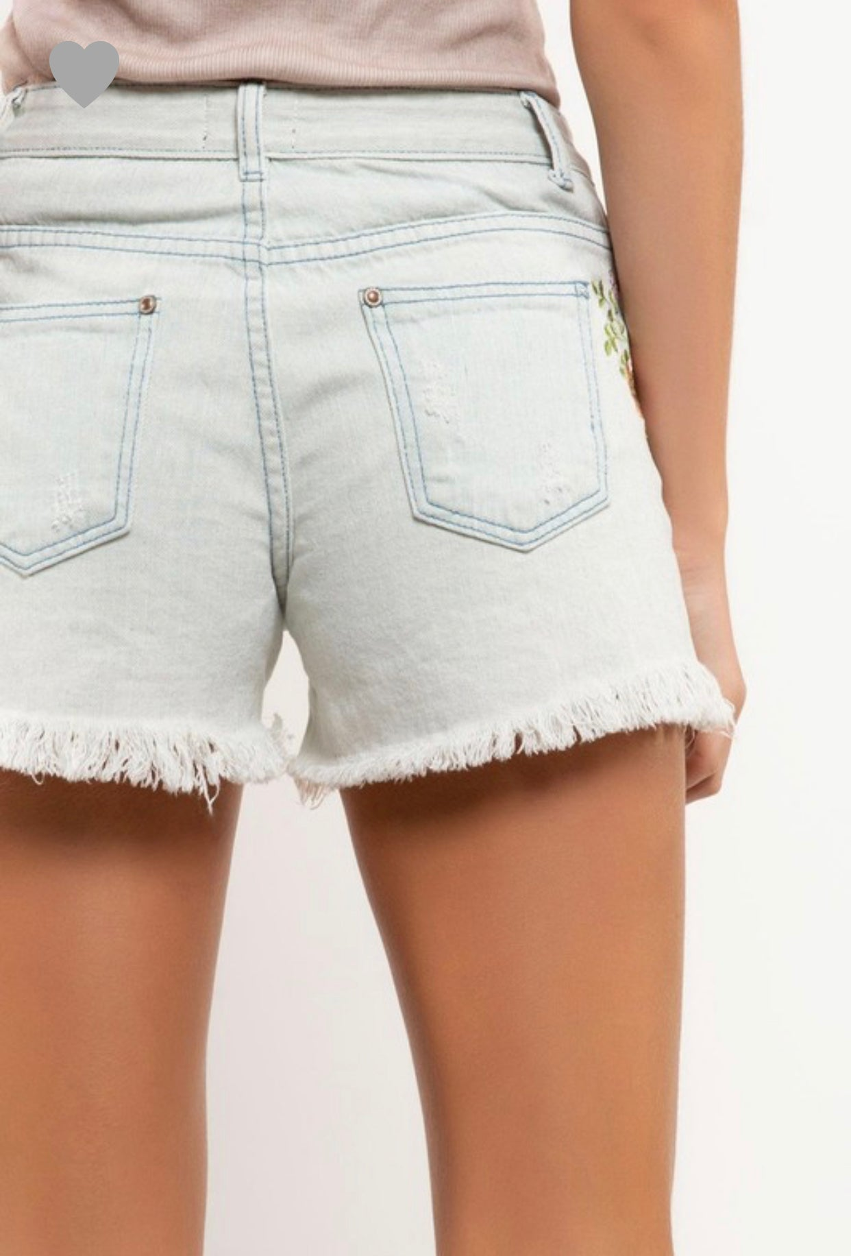 Distressed floral denim shorts