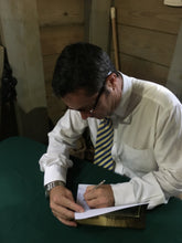 Load image into Gallery viewer, Dr. Mitch Kent, author signing his book.