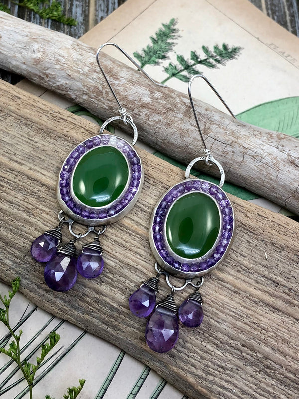 So bold, so beautiful, the combination of purple and green has always been my favorite.  Since I was twelve years old and crafted my very first pair of earrings in this color combination with wooden beads, I have always thought purple and green were the perfect pair.  Ovals of nephrite jade are surrounded by halos of ombre faceted amethyst gems ranging from pale pink to deep purple. Accented with hand stamping and six faceted amethyst teardrops, these earrings are finished on extra lon